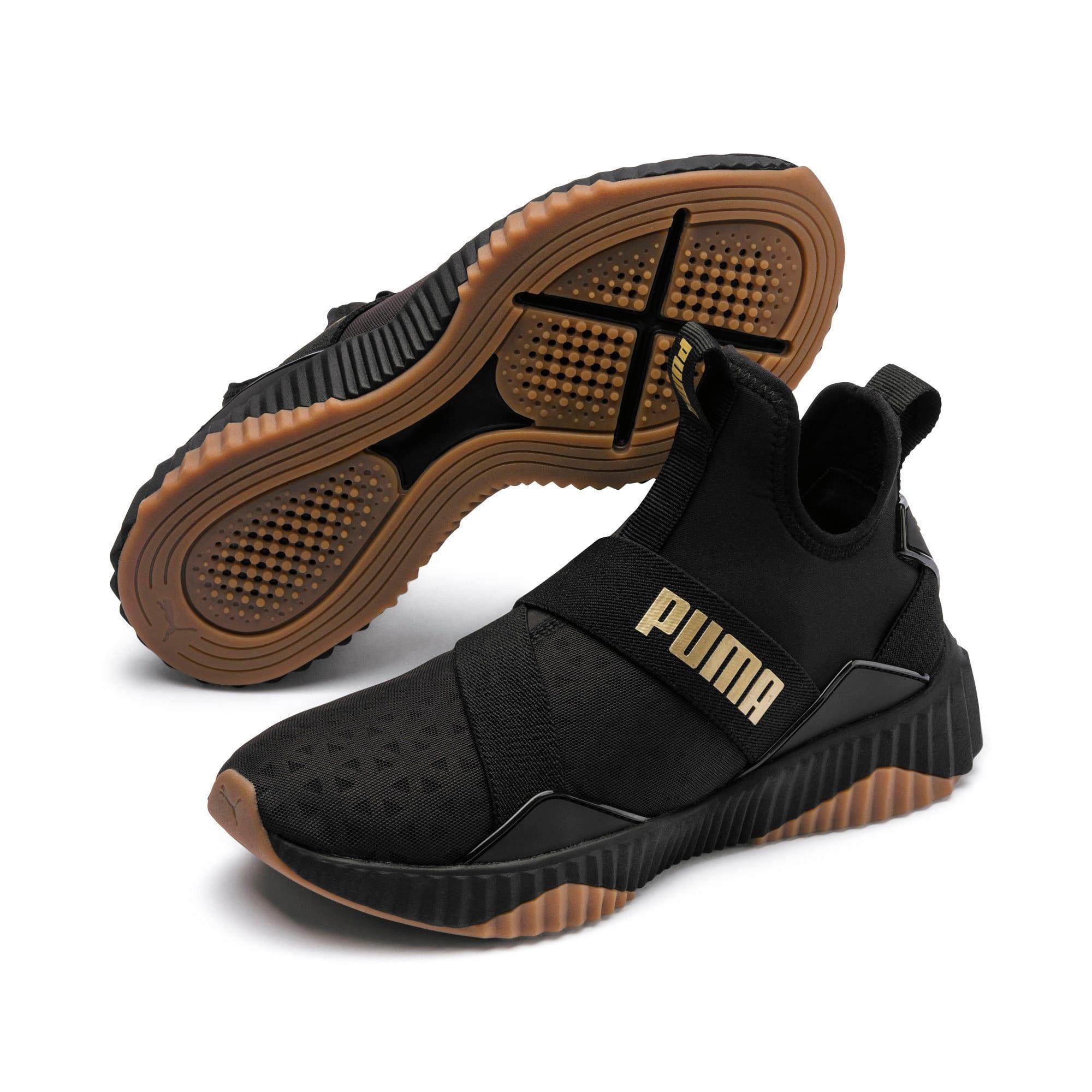 Thumbnail 3 of Defy Mid Sparkle Women's Training Shoes, Puma Black-Metallic Gold, medium