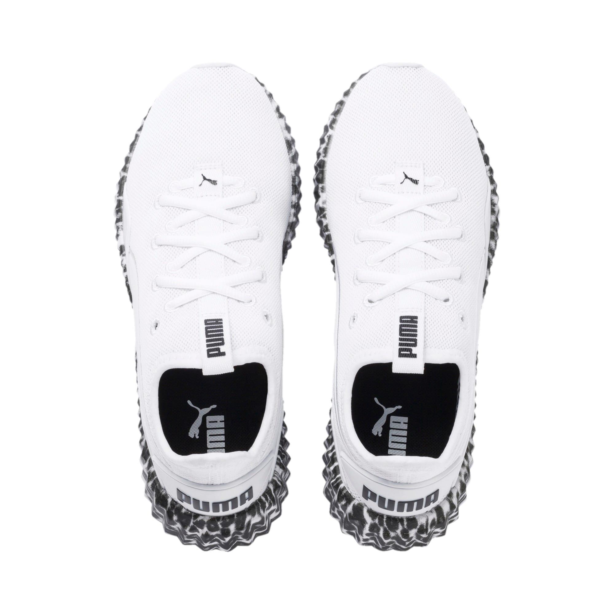 Thumbnail 7 of Defy Leopard Women's Sneakers, Puma White-Puma Black, medium