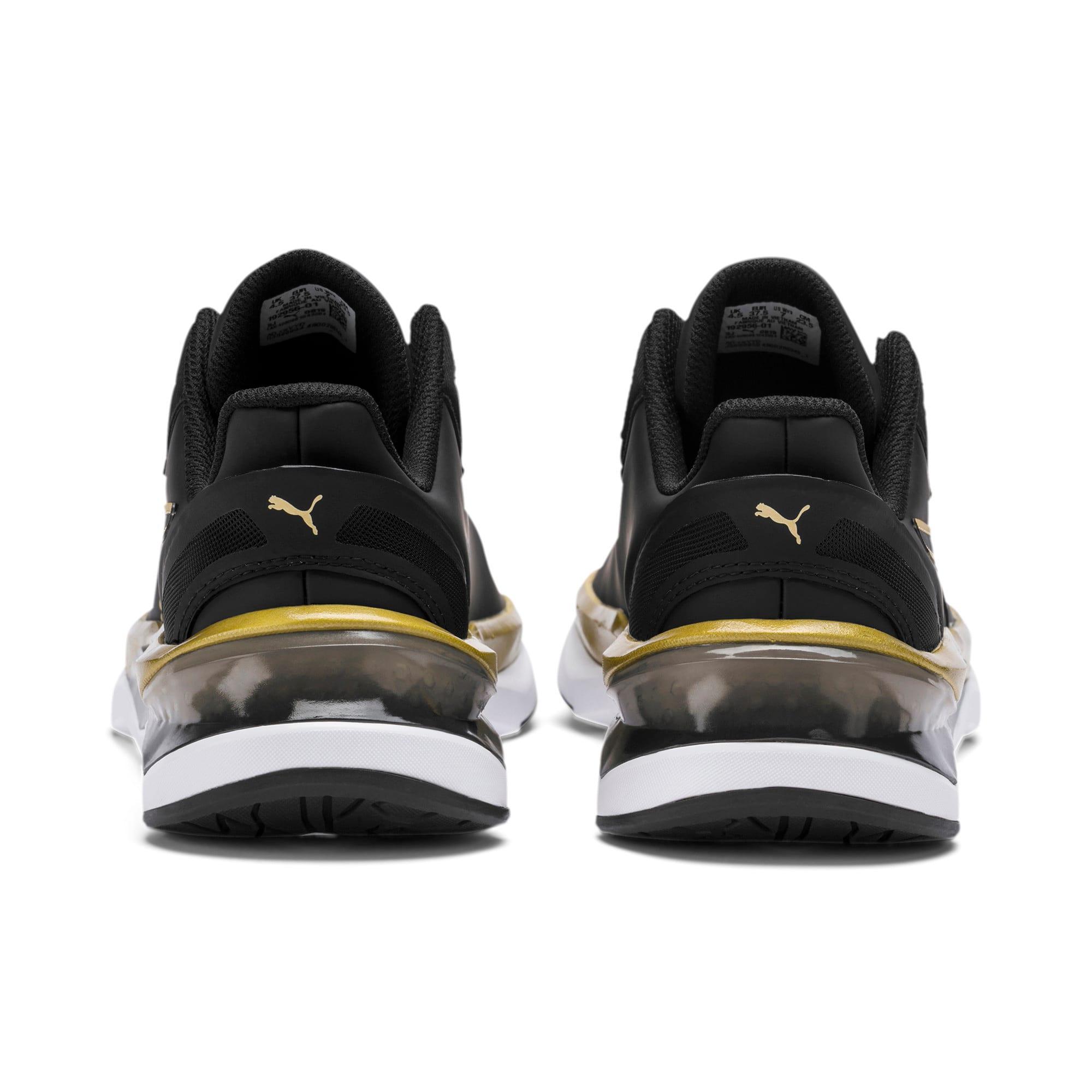 Thumbnail 3 of Shatter XT Matte LQDCELL Women's Running Shoes, Puma Black-Puma Team Gold, medium