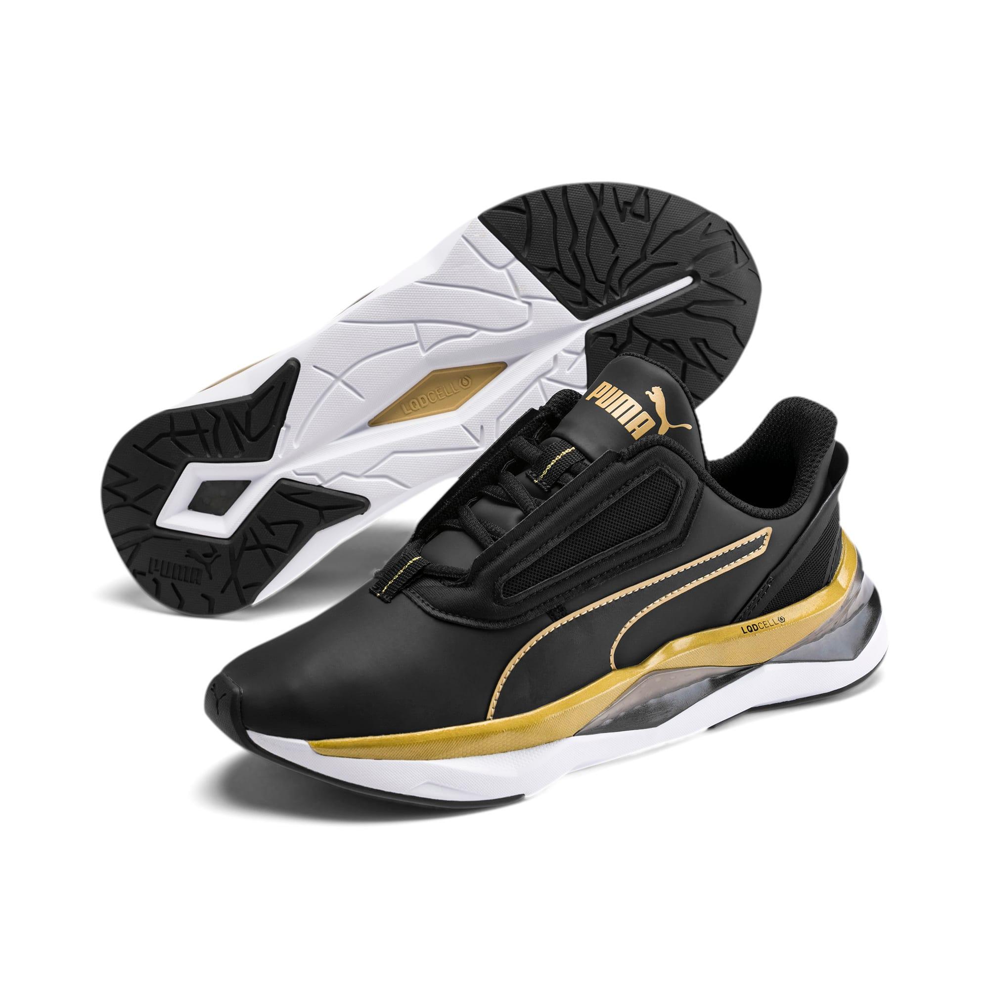 Thumbnail 2 of Shatter XT Matte LQDCELL Women's Running Shoes, Puma Black-Puma Team Gold, medium