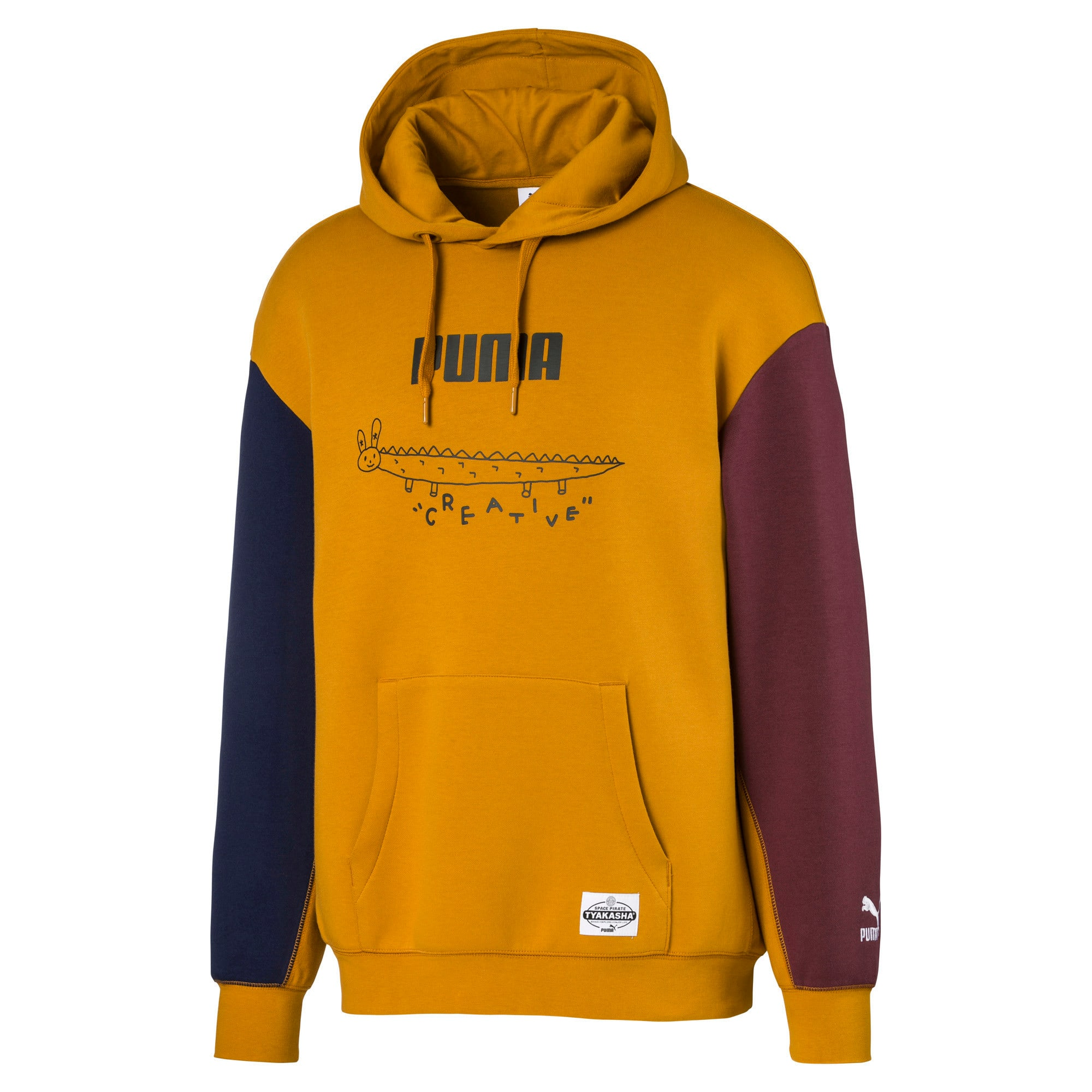Thumbnail 1 of PUMA x TYAKASHA Herren Hoodie, Buckthorn Brown, medium