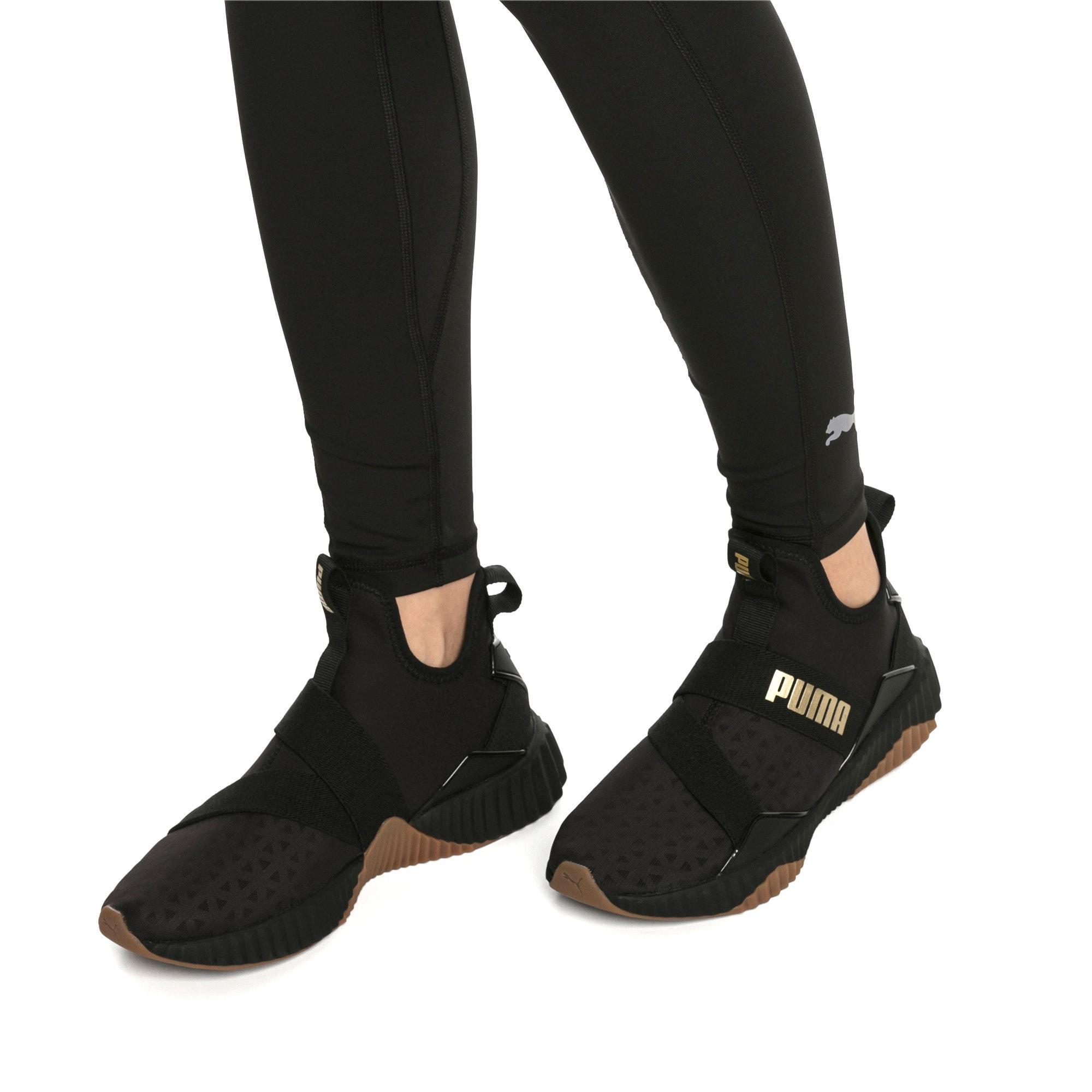 Thumbnail 2 of Defy Mid Sparkle Women's Training Shoes, Puma Black-Metallic Gold, medium