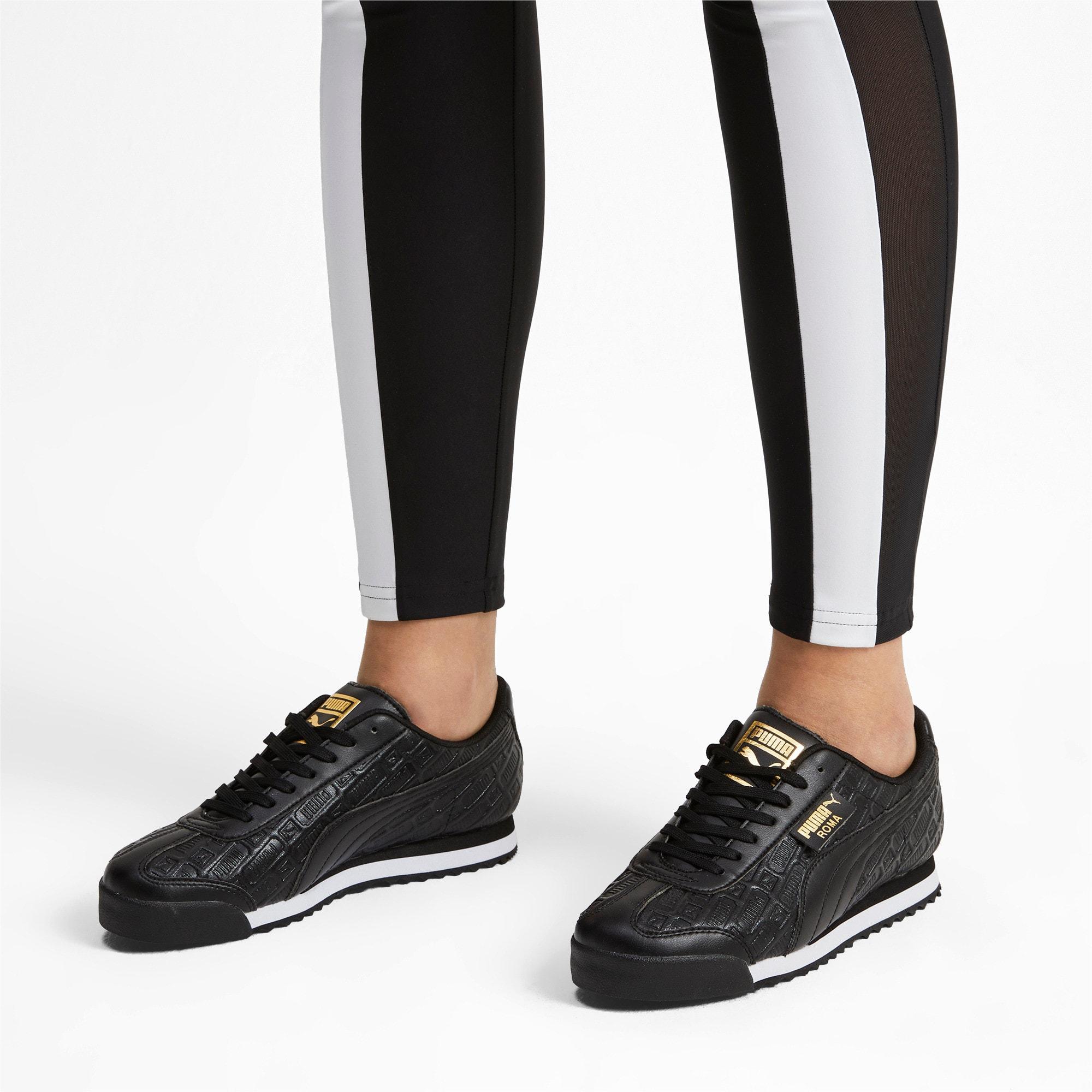 Thumbnail 2 of Roma Reinvent Women's Sneakers, Puma Black-Puma Team Gold, medium